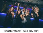 Group Of Friends At Club Havin...