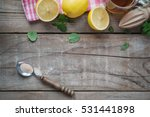 wooden table with fresh lemon