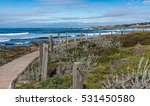 A Boardwalk Along Coastal Sand...