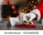Hand Of Santa Claus Putting...