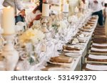 white plates stand in the row... | Shutterstock . vector #531492370