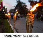 Closeup Of Flaming Torches...