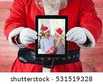 Santa Claus Holding A Digital...