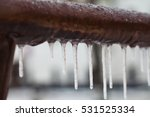 Icicles Hanging From A Brown...