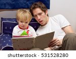 father and toddler son reading... | Shutterstock . vector #531528280