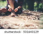 young woman hiker stops to tie... | Shutterstock . vector #531643129