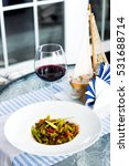 glass of red wine  meat with...