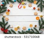 Christmas cookies with candy and  festive branches fir. Homemade delicious Christmas gingerbread cookies on the wooden background. Free space for your text