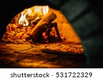 pizza and brick pizza oven with ... | Shutterstock . vector #531722329