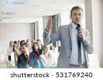 Businessman Speaking Through...