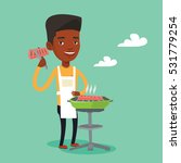 an african american man cooking ... | Shutterstock .eps vector #531779254