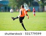boy  goalkeeper kicking soccer... | Shutterstock . vector #531779599