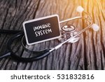 stethoscope on wood with immune ... | Shutterstock . vector #531832816