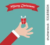 santa hand with gift. christmas ... | Shutterstock .eps vector #531858034