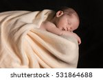 Newborn Baby Sleeping On A...