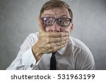 shocked man covering mouth | Shutterstock . vector #531963199