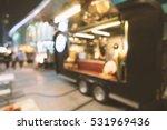 blurred of food trucks parking. | Shutterstock . vector #531969436