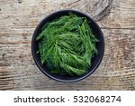 Bowl Of Fresh Dill On Wooden...