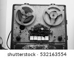 Black and white art photography monochrome, Old retro film recorder. Musical instrument on a gray background.