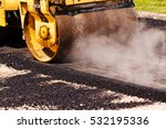 Small photo of asphalting of the road with steamroller