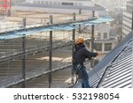 Small photo of Industrial abseiler on the rooftop