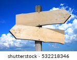 Empty Wooden Signpost With Two...