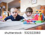 baby boy and big sister play... | Shutterstock . vector #532322083