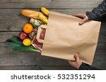 man holding bag full of... | Shutterstock . vector #532351294