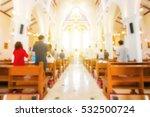 Blurred Christian Mass Praying...