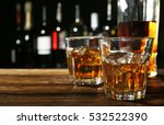 glasses of whisky on wooden bar ...   Shutterstock . vector #532522390