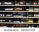 Shelves With Alcohol Bottles In ...