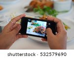 using hands to take food's... | Shutterstock . vector #532579690