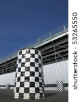 checkered trash cans outside a sports arena grandstand - stock photo