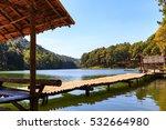 Bamboo Bridge And Hut In Lake...