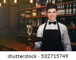 male waiter holding tray with... | Shutterstock . vector #532715749