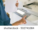 asian man using copy machine.... | Shutterstock . vector #532741084