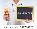 Small photo of Alzheimer's Disease Chalkboard Sign Held By Female Doctor Holding Prescription Bottle.