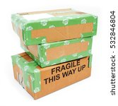 Small photo of A pile of 3 wrapped up parcels on a white background, with blank labels and green recycled parcel tape