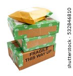 Small photo of A pile of 4 wrapped up parcels on a white background, with blank labels and green recycled parcel tape