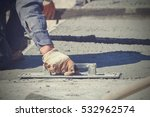 construction workers leveling... | Shutterstock . vector #532962574