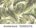 Stock vector tropical palm leaves jungle leaf seamless vector floral pattern background 533001376