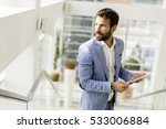 view at businessman using his... | Shutterstock . vector #533006884