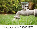 water drop from old faucet... | Shutterstock . vector #533059270
