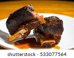beef short ribs with sauce | Shutterstock . vector #533077564