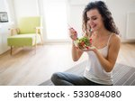 woman eating healthy salad... | Shutterstock . vector #533084080