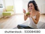 Woman Eating Healthy Salad...