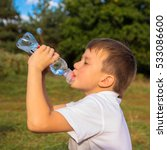little boy drinks water from a... | Shutterstock . vector #533086600
