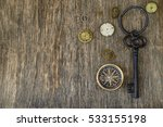 Old Key On Wooden Background.