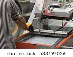 worker and machine cutting a... | Shutterstock . vector #533192026