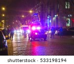 Small photo of Blurred police car on the street at night. Orange cones set up to direct traffic around a police car in the collision scene. Great background blur